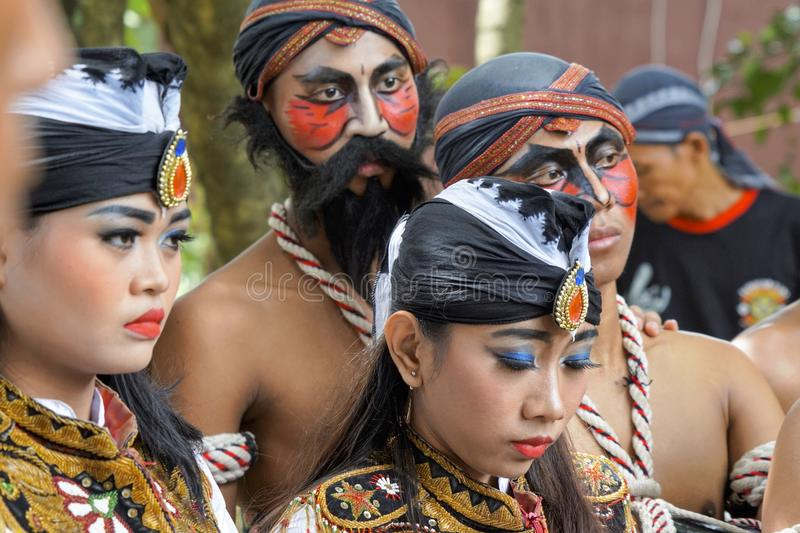 Dancers listen to final instructions before the show. Female and male dancers in costumes and makeups listen to final guidance from their instructor before the stock photos