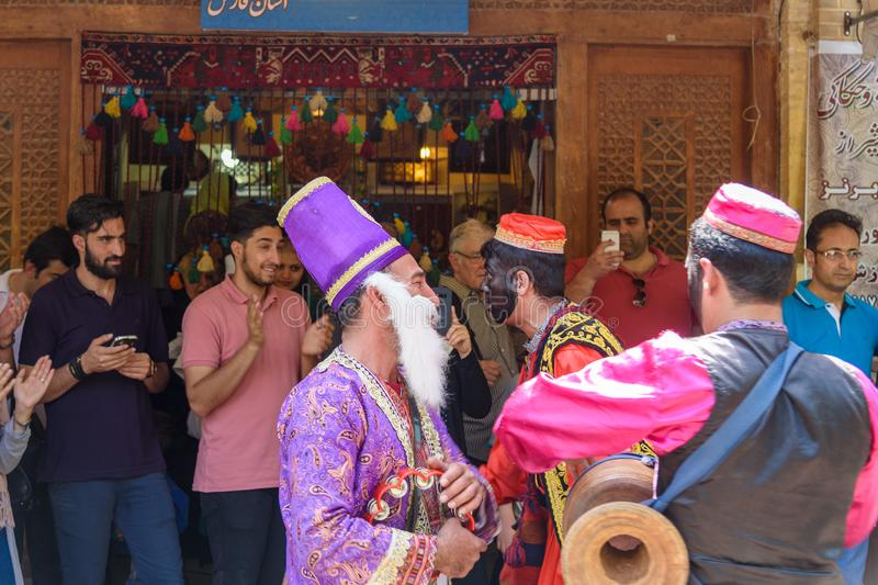 Dancers musicians with black face dance in the street in Bazaar to spread good cheer in Nowruz holidays. Shiraz. Iran. Shiraz, Iran - March 25, 2018: Dancers royalty free stock image