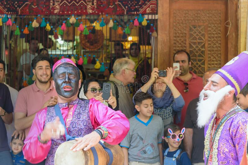 Dancers musicians with black face dance in the street in Bazaar to spread good cheer in Nowruz holidays. Shiraz. Iran. Shiraz, Iran - March 25, 2018: Dancers stock photo