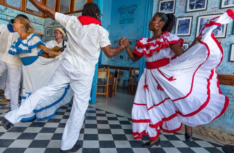 Dancers and musicians perform cuban folk dance. Dancers in costumes and musicians perform traditional cuban folk dance in cafe in Trinidad. Cuba, spring 2018 stock images