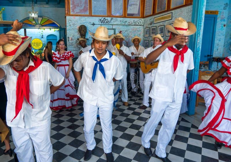 Dancers and musicians perform cuban folk dance. Dancers in costumes and musicians perform traditional cuban folk dance in cafe in Trinidad. Cuba, spring 2018 stock photos