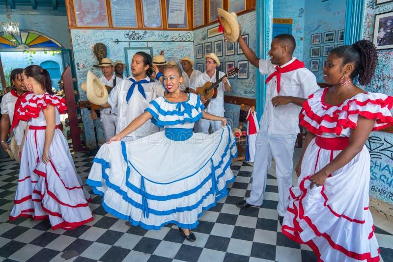 Dancers and musicians perform cuban folk dance stock photos