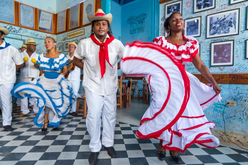 Dancers and musicians perform cuban folk dance stock photo