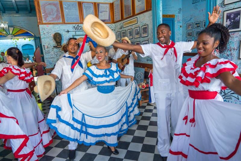 Dancers and musicians perform cuban folk dance. Dancers in costumes and musicians perform traditional cuban folk dance in cafe in Trinidad. Cuba, spring 2018 stock image