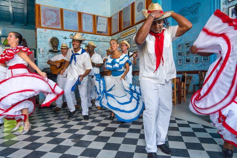 Dancers and musicians perform cuban folk dance. Dancers in costumes and musicians perform traditional cuban folk dance in cafe in Trinidad. Cuba, spring 2018 stock photo