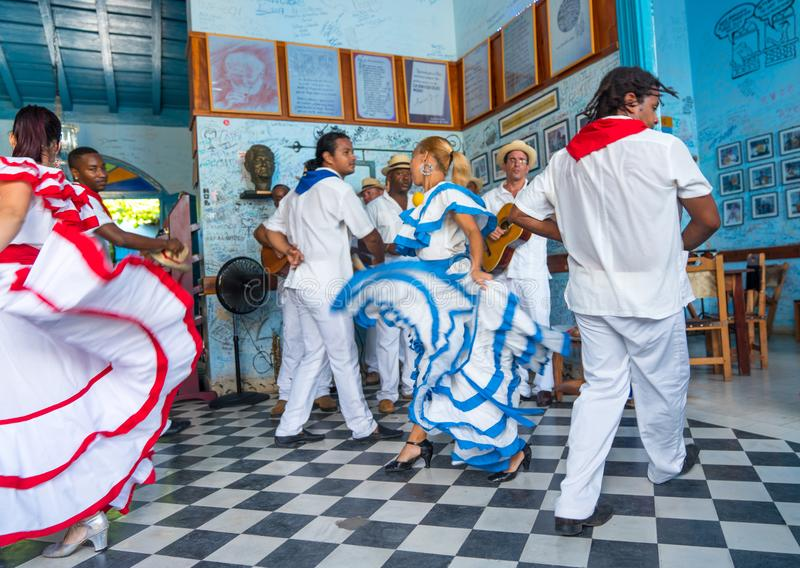 Dancers and musicians perform cuban folk dance. Dancers in costumes and musicians perform traditional cuban folk dance in cafe in Trinidad. Cuba, spring 2018 stock photos