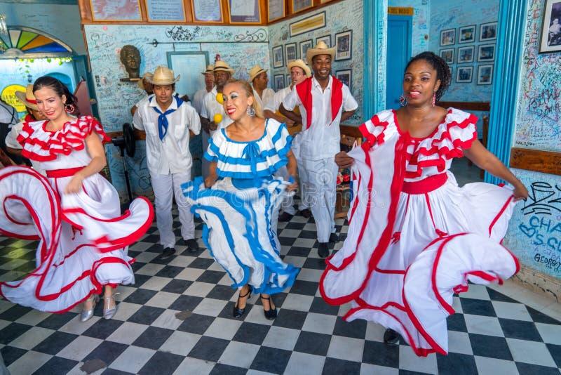 Dancers and musicians perform cuban folk dance stock photography