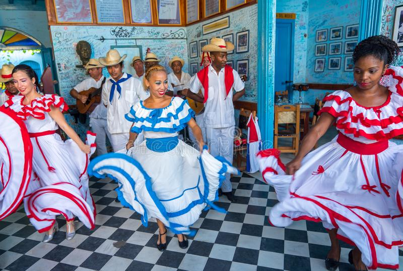 Dancers and musicians perform cuban folk dance. Dancers in costumes and musicians perform traditional cuban folk dance in cafe in Trinidad. Cuba, spring 2018 stock image