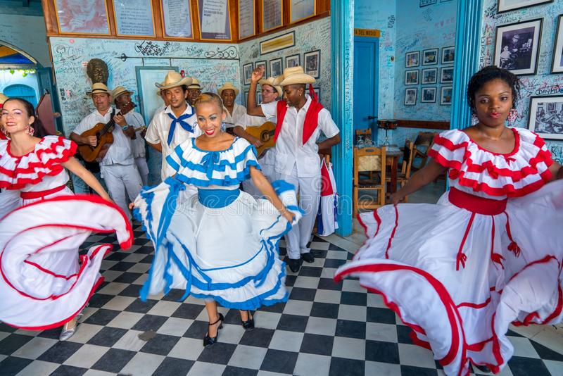 Dancers and musicians perform cuban folk dance stock photography