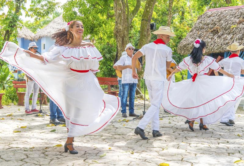 Dancers and musicians perform cuban folk dance. Dancers in costumes and musicians perform traditional cuban folk dance. Cuba, spring 2018 royalty free stock images