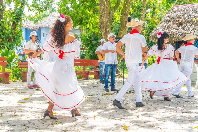 Dancers and musicians perform cuban folk dance. Dancers in costumes and musicians perform traditional cuban folk dance. Cuba, spring 2018 stock images
