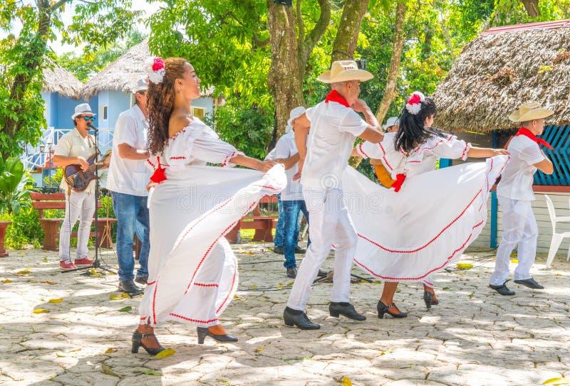 Dancers and musicians perform cuban folk dance. Dancers in costumes and musicians perform traditional cuban folk dance. Cuba, spring 2018 royalty free stock photo
