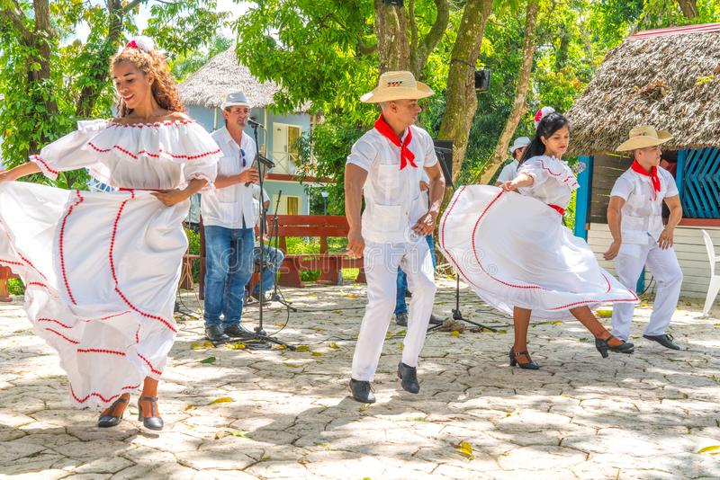 Dancers and musicians perform cuban folk dance. Dancers in costumes and musicians perform traditional cuban folk dance. Cuba, spring 2018 royalty free stock photography