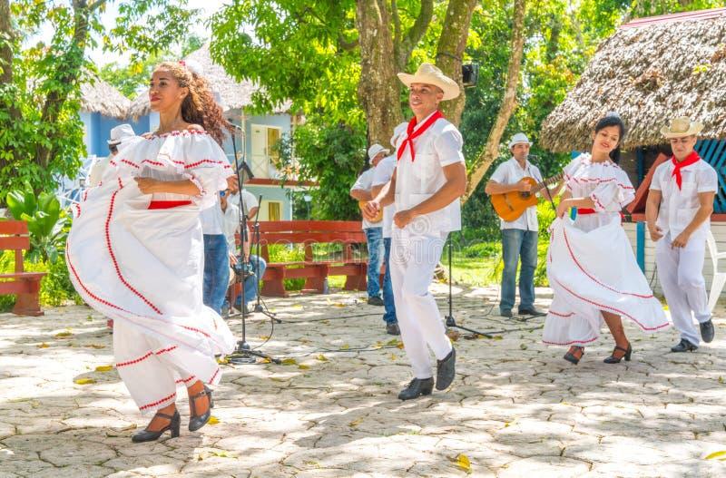 Dancers and musicians perform cuban folk dance. Dancers in costumes and musicians perform traditional cuban folk dance. Cuba, spring 2018 stock image