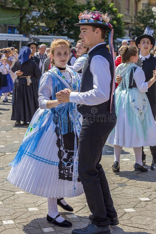 Dancers at the parade of the German folk costumes, Timisoara, Romania. TIMISOARA,ROMANIA-JUNE 16, 2019:Dancers at the parade of the Swabian folk costumes on the stock images