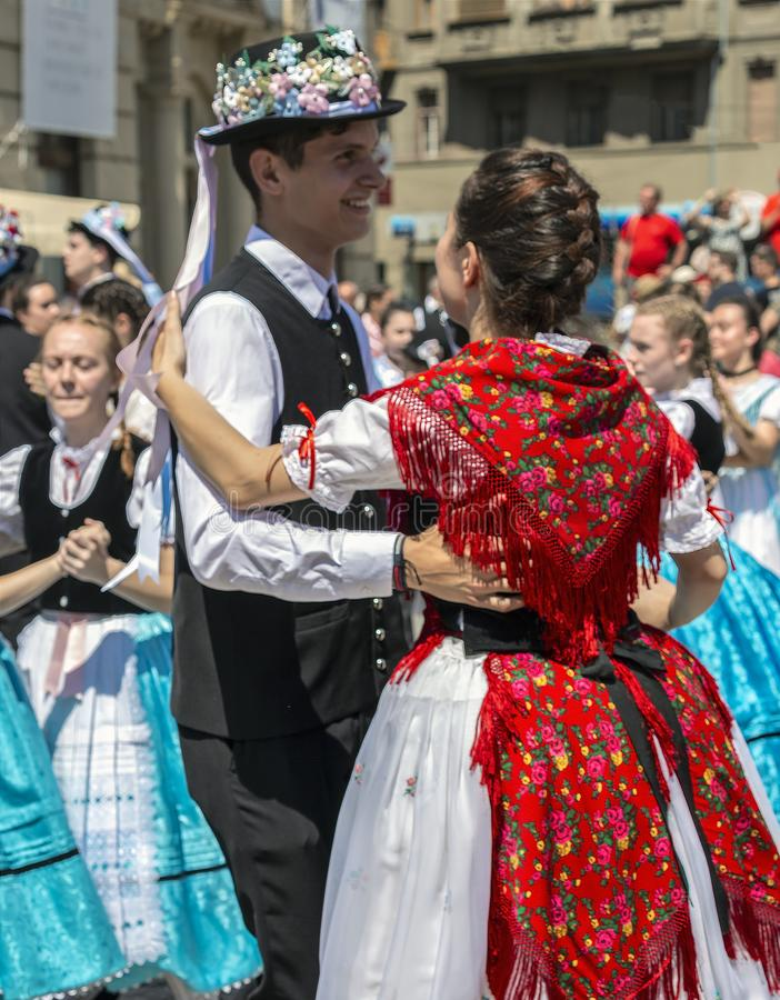 Dancers at the parade of the Swabian folk costumes, Timisoara, Romania. TIMISOARA,ROMANIA-JUNE 16, 2019:Dancers at the parade of the Swabian folk costumes on the stock images