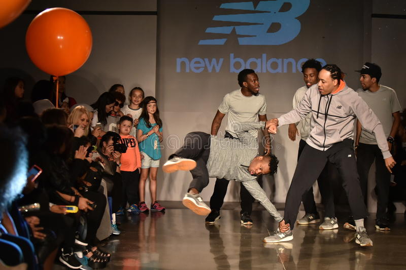 Dancers perform on runway at New Balance Fall/Winter 2016 Runway Dance Party during petiteParade. NEW YORK, NY - OCTOBER 17: Dancers perform on runway at New royalty free stock images