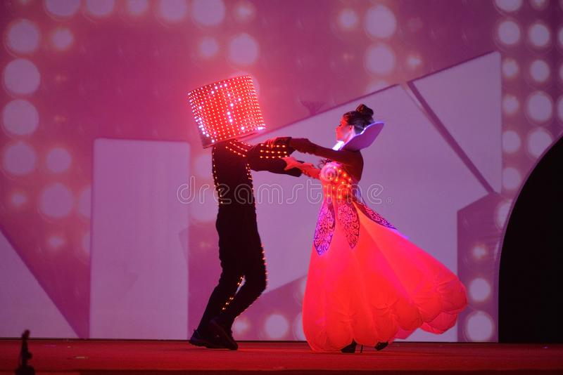 Dancers with Red Lighted Garments, Artists Performance, Fairy Tale, Led Lights Attire, Dinner Party Event stock photography