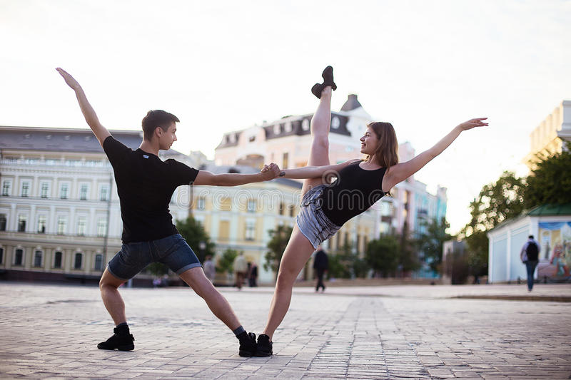 Dancers on the street. Boy and girl jumping and dancing on city streets royalty free stock photo