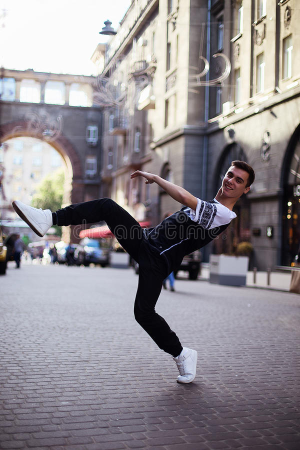 Dancers on the street. Boy jumping and dancing on city streets stock images