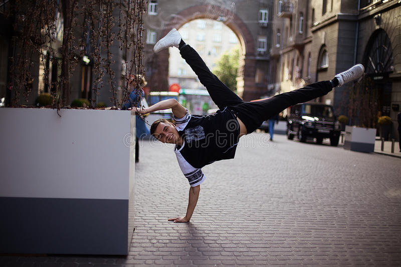 Dancers on the street. Boy jumping and dancing on city streets royalty free stock photo