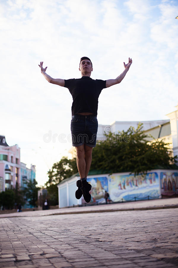Dancers on the street. Boy jumping and dancing on city streets royalty free stock image