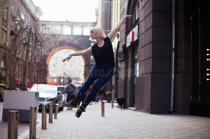 Dancers on the street. Girl jumping and dancing on city streets royalty free stock photo