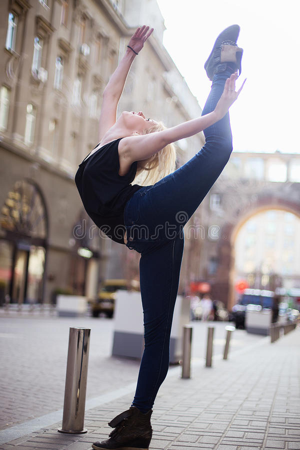 Dancers on the street. Girl jumping and dancing on city streets stock images