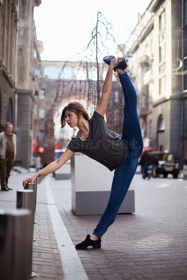 Dancers on the street. Girl jumping and dancing on city streets stock photography