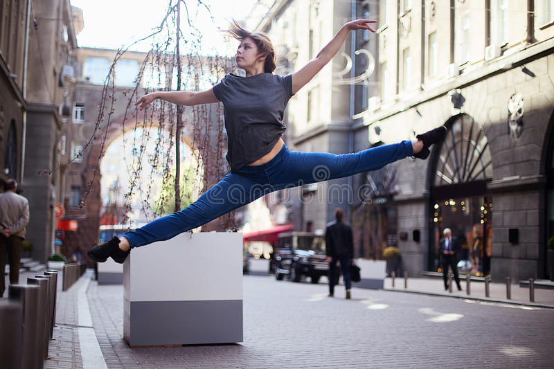 Dancers on the street. Girl jumping and dancing on city streets stock photo