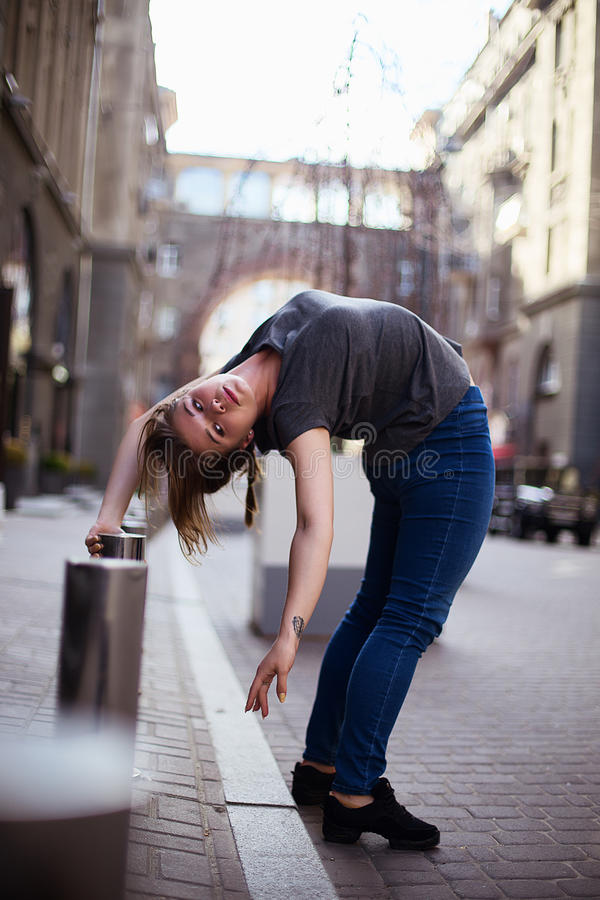 Dancers on the street. Girl jumping and dancing on city streets royalty free stock photos