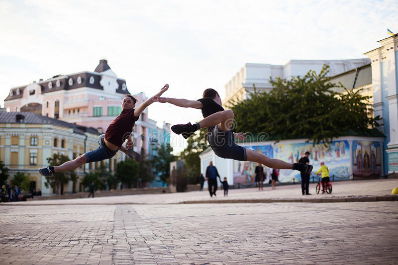 Dancers on the street. Two boys jumping and dancing on city streets stock image