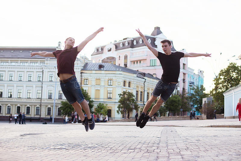 Dancers on the street. Two boys jumping and dancing on city streets royalty free stock photos