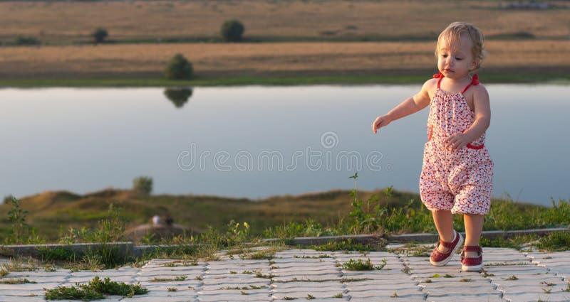Dancing baby-girl outdoor stock photo