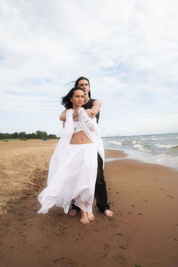 Dancing on the beach stock photos