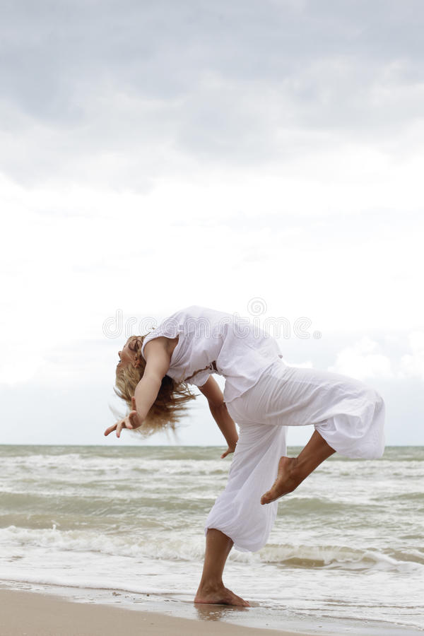 Dancing on the beach royalty free stock images