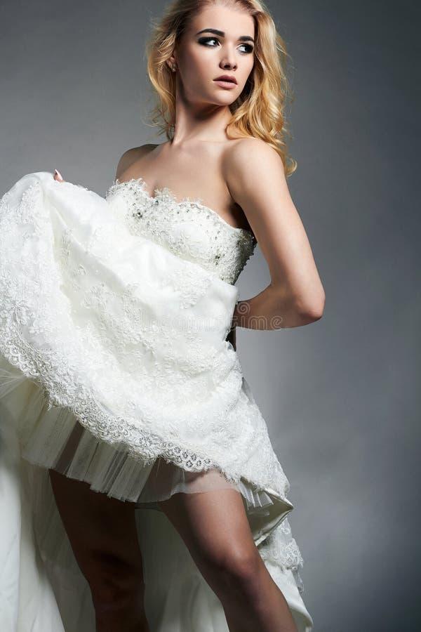 Dancing beautiful bride woman in wedding dress stock image
