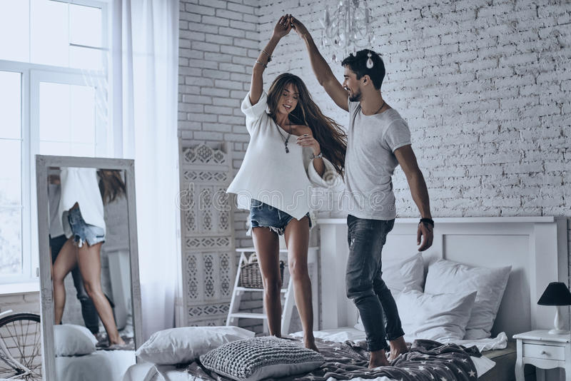 Download Dancing on the bed. stock photo. Image of indoors, couple - 89508870