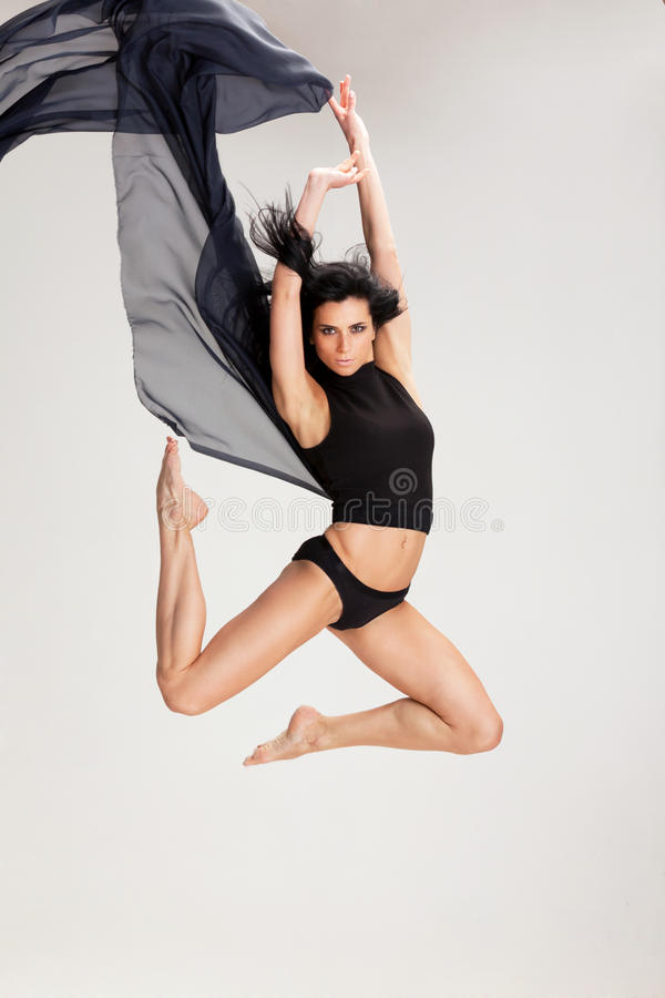 Dancing with black. Female dancing with black fabric stock images