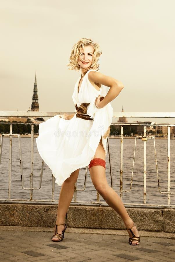 Dancing blond girl stock photo