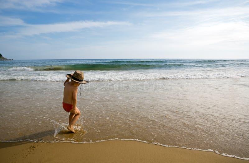 Dancing boy.beach. Dancing boy.coast.beach.evening royalty free stock photography