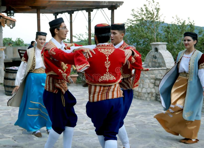 Dancing boys. Beautiful dancers and singers at the nice folk style evening meal in Montenegro stock photo