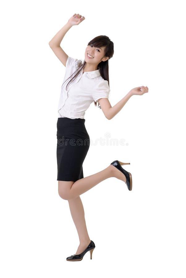 Dancing business woman stock image