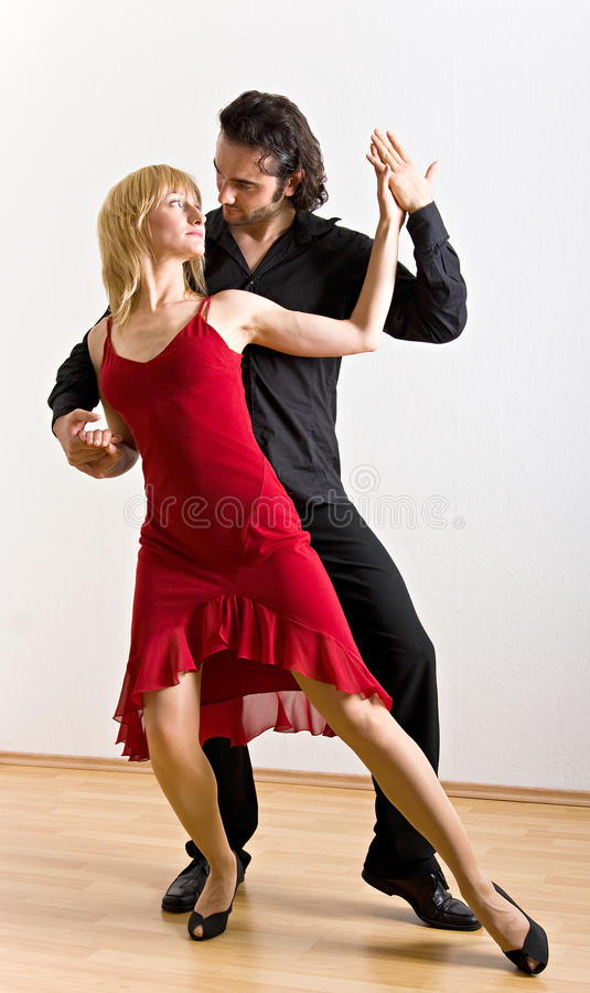 A dancing couple. Picture of a salsa dancing couple royalty free stock photography