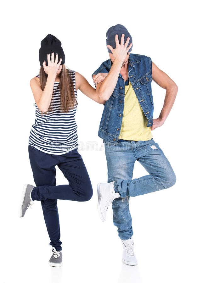 Dancing. A couple of young men and women dancing hip-hop at studio royalty free stock photo