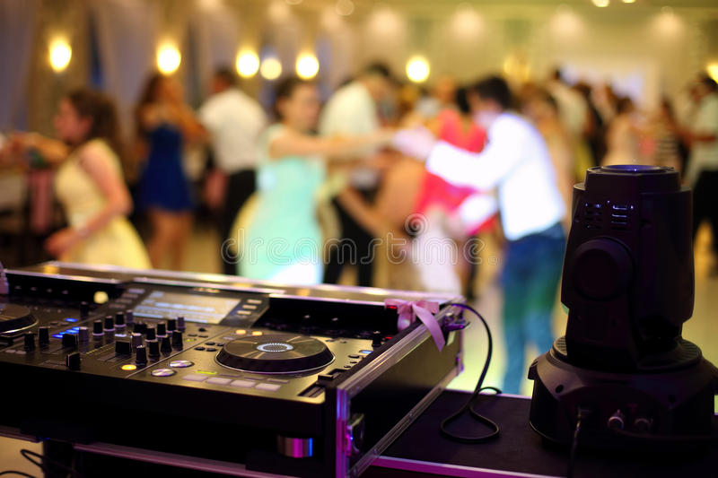 Dancing couples during party or wedding celebration. By dj mixer stock photo