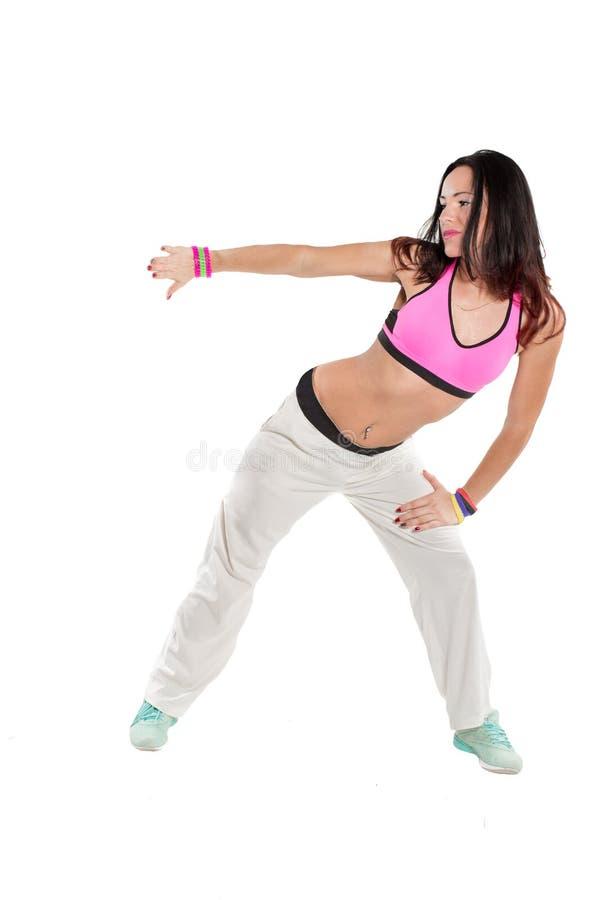Dancing della giovane donna isolato su fondo bianco. Ballo godente femminile felice di forma fisica. immagini stock
