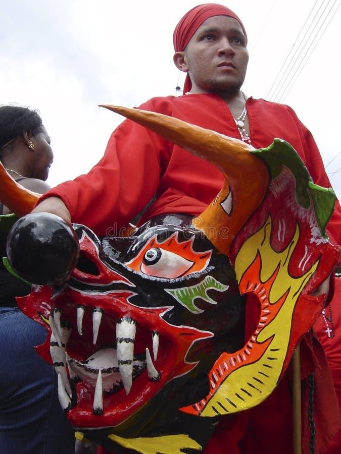Dancing Devils of Yare, a set of popular Venezuelan religious festivals held on Corpus Christi. Yare/Venezuela 05/06/2012: Dancing Devils of Yare, a set of stock photo