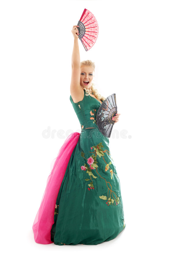 Dancing with fans #2. Lady in green dress dancing with fans over white royalty free stock photography