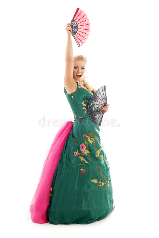 Dancing with fans #2. Lady in green dress dancing with fans over white stock photo